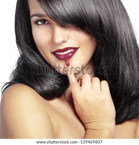 Portrait of young beautiful woman with glossy hair - stock photo