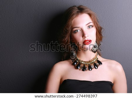 Portrait of young beautiful woman with jewelry - stock photo