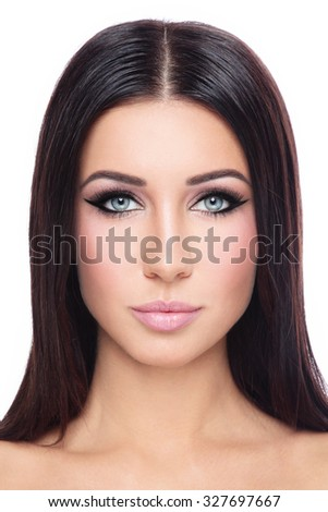 Portrait of young beautiful woman with long straight hair and stylish winged eyes over white background - stock photo