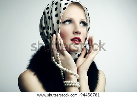 Portrait of young beautiful woman with pearl necklace. Fashion photo - stock photo