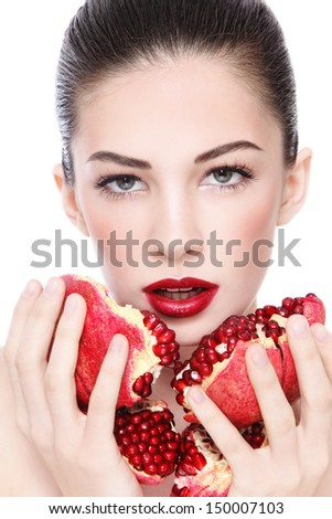 Portrait of young beautiful woman with pomegranates in her hands, over white background - stock photo