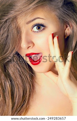 portrait of young beautiful woman with red lipstick. filtered in warm tone - stock photo