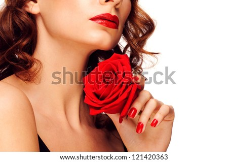 Portrait of young beautiful woman with red lipstick holding red rose. Isolated on white background - stock photo