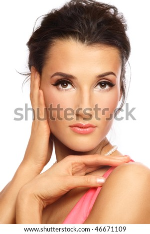 Portrait of young beautiful woman with stylish coral make-up touching her head - stock photo