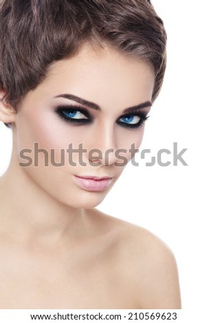 Portrait of young beautiful woman with stylish short haircut and smoky eyes over white background - stock photo
