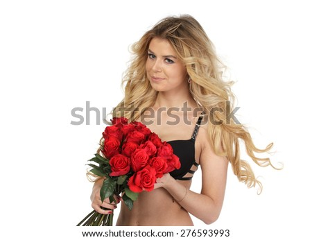 Portrait of young beautiful young woman with set of roses, isolated - stock photo