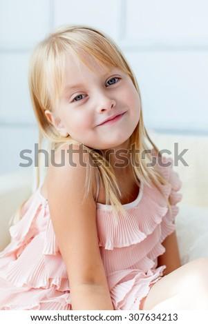 Portrait of young blond girl. Studio shot - stock photo