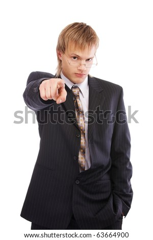 portrait of young blond man in black suit pointing his finger at the camera - stock photo