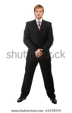 portrait of young blond man in suit on white - stock photo
