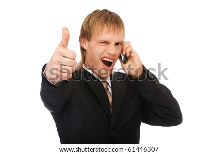 portrait of young blond man in suit speaking on phone and showing tumb up on white - stock photo