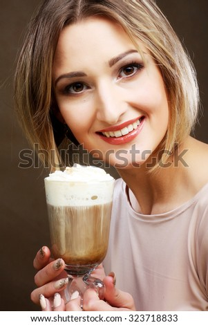 Portrait of young blond woman holding cafe latte cup  - stock photo