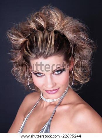 Portrait of young blond woman, with hair professionally done. - stock photo