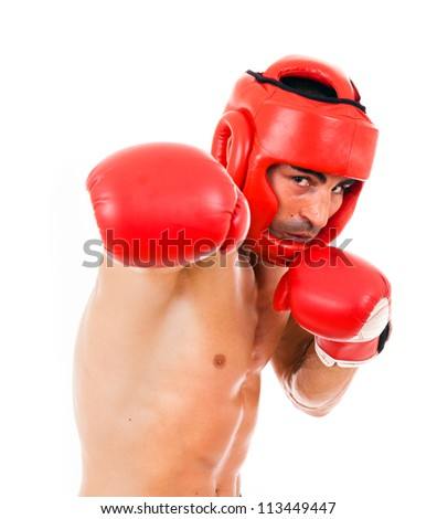 Portrait of young Boxer fighter with boxing helmet and gloves over white background - stock photo