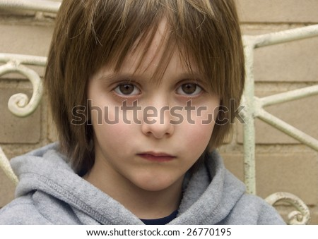 portrait of young boy looking serious - stock photo