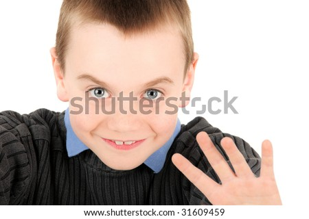 Portrait of young boy waving, studio shot - stock photo