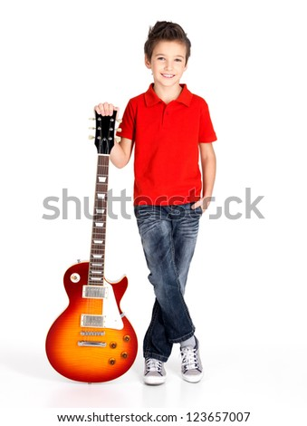 Portrait of young boy with a electric guitar - isolated on white background - stock photo
