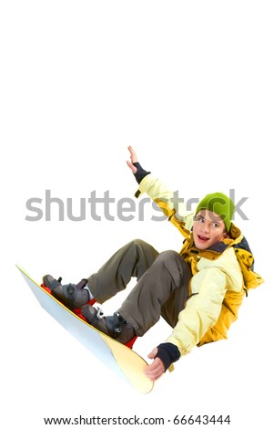 Portrait of young boy with snowboard jumping and looking aside - stock photo