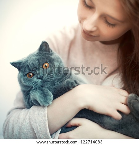 Portrait of young brunette with british cat - stock photo