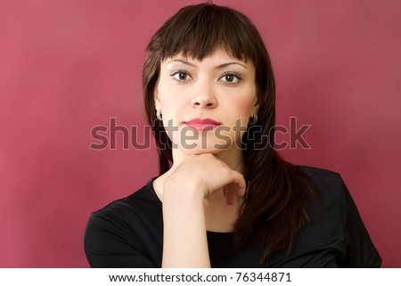 portrait of young brunette woman on a red burgundy background - stock photo