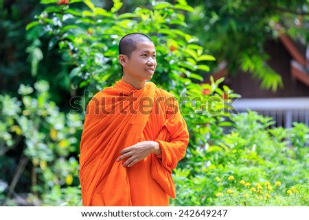 Portrait of Young Buddhist Monk at Sunny Day - stock photo