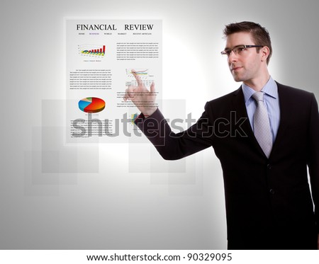 Portrait of young business man pressing modern screen on a virtual background - stock photo