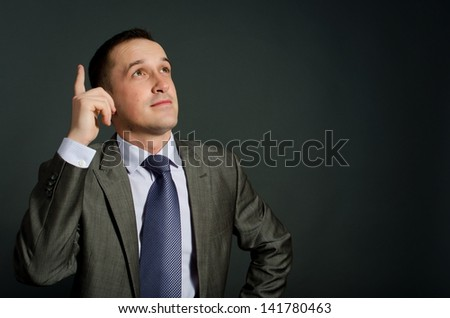 portrait of young business man thinking - stock photo