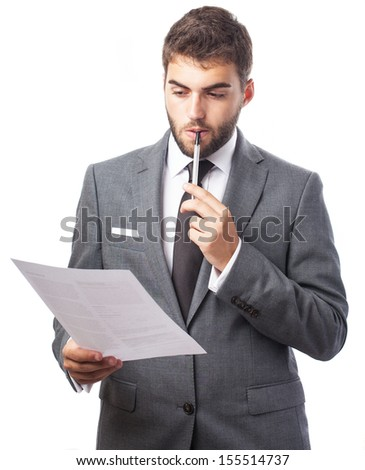 portrait of young business man thinking about a contract on white - stock photo