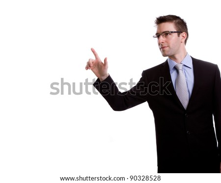 Portrait of young business man touching an imaginary screen against white background - stock photo