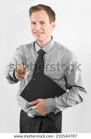 Portrait of young business man with clipboard isolated on white background - stock photo
