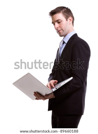 Portrait of young business man with laptop against white background - stock photo