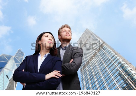 Portrait of young business people looking to the future with city background - stock photo