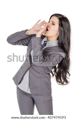 portrait of young business woman in grey suit loud screaming or calling out to someone. image on a white studio background. Negative human emotion expression and lifestyle concept - stock photo