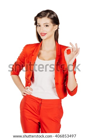 portrait of young business woman in red suit indicating OK sign. isolated on white background. business and lifestyle concept - stock photo