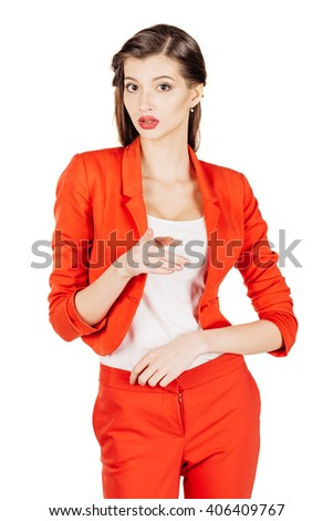 portrait of young business woman in red suit pointing at you and showing copy space. isolated on white background. business and lifestyle concept - stock photo