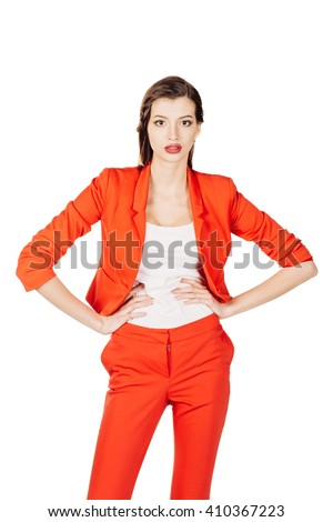portrait of young business woman in red suit with arms akimbo, looking to you. human emotion expression and lifestyle concept. image on a white studio background. - stock photo