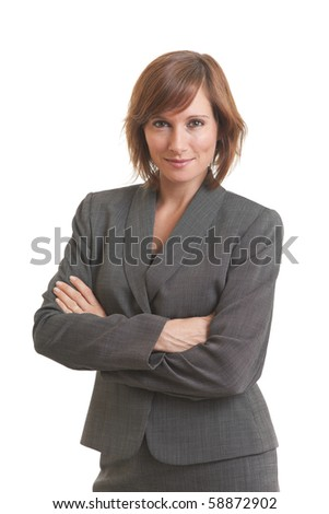Portrait of young business woman with arms crossed - stock photo
