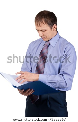 Portrait of young businessman examining documents, isolated on white - stock photo