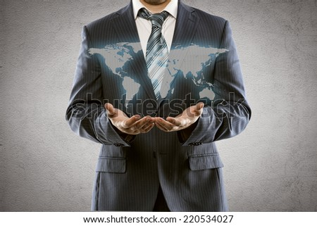 Portrait of young businessman holding world map. International business, export sales increase and start up concept. - stock photo