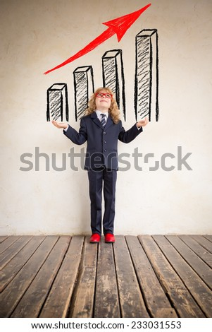 Portrait of young businessman in modern loft office. Business growth. Drawn bar chart. Success, creative and innovation concept. Copy space for your text - stock photo