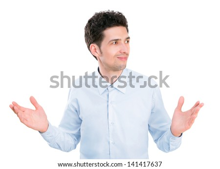 Portrait of young businessman in shirt with palms up having confused expression and no ideas.  Isolated on white background. - stock photo
