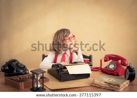 Portrait of young businessman kid in office. Success and creative in business concept - stock photo