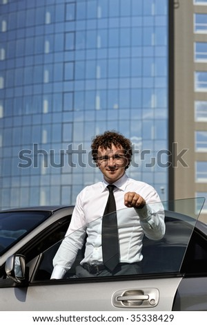 Portrait of young businessman outdoors - stock photo