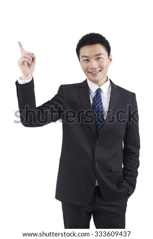 Portrait of young businessman standing in white background - stock photo
