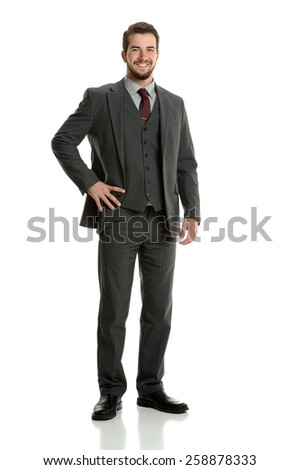 Portrait of young businessman standing isolated over white background - stock photo