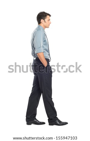 Portrait Of Young Businessman Walking With Hand In Pocket Isolated On White Background  - stock photo