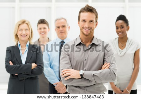 Portrait Of Young Businessman With Business Team - stock photo