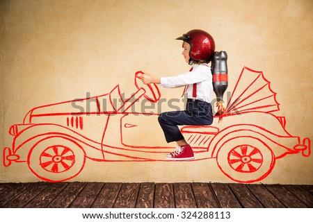 Portrait of young businessman with jet pack riding drawing retro car. Success, creative and innovation technology concept. Copy space for your text - stock photo