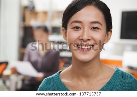 Portrait of young businesswoman in the office - stock photo