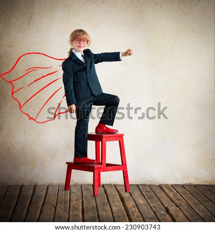 Portrait of young businesswoman superhero in modern loft office. Success, creative and innovation concept. Copy space for your text - stock photo