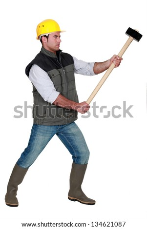 portrait of young carpenter holding hammer - stock photo